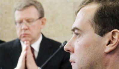 Dmitij Miedwiediew, w tle Aleksiej Kudrin